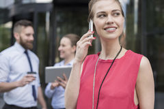Busy business people. Talking by mobilephone with cutomers Royalty Free Stock Photography