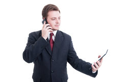 Busy business person using phone and tablet as multitasking conc Stock Images