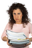 Busy business woman. Carrying stacked files over a white background Royalty Free Stock Photos