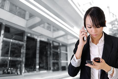 Busy business woman Stock Image
