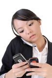 Busy business woman. Phoning someone and reading SMS against white Stock Photo