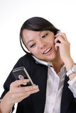 Busy business woman. With smiling expression talking on cellphone Royalty Free Stock Images