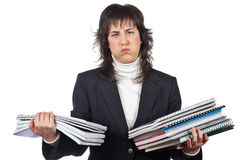 Busy business woman carrying stacked files. Over a white background Stock Photo