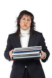 Busy business woman carrying stacked files. Over a white background Stock Image