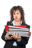 Busy business woman carrying stacked files. Over a white background Royalty Free Stock Photo