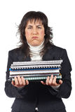 Busy business woman carrying stacked files. Over a white background Royalty Free Stock Image