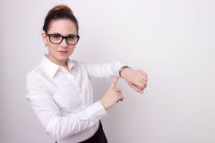 Busy business woman checking the time Royalty Free Stock Photos