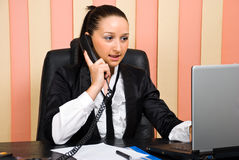 Busy business woman in office Stock Images