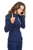 Busy business woman talking cell phone. Isolated on white Royalty Free Stock Image