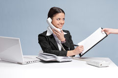 Busy business woman talking by phone Royalty Free Stock Image