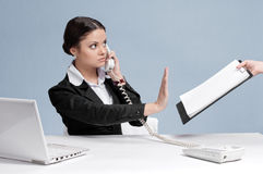 Busy business woman talking by phone Stock Image