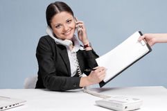 Busy business woman talking by phone Royalty Free Stock Photography