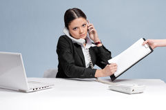 Busy business woman talking by phone Stock Photography