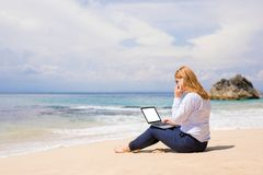Business woman working on the beach royalty free stock images