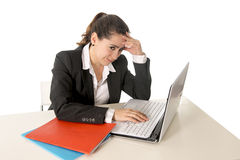 Busy business woman working on her laptop Royalty Free Stock Image