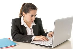 Busy business woman working on her laptop Stock Image