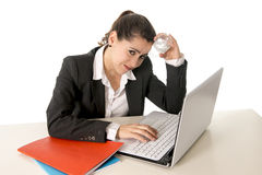 Busy business woman working on her laptop Stock Images