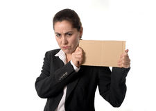 Busy business woman working on her laptop blank sign Stock Photo