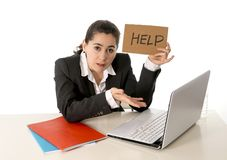 Busy business woman working on her laptop help sign Stock Image