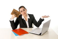 Busy business woman working on her laptop help sign Stock Photography