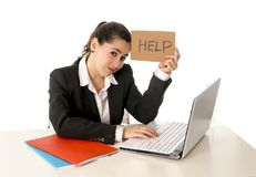Busy business woman working on her laptop help sign Stock Images