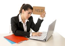 Busy business woman working on her laptop help sign Royalty Free Stock Images
