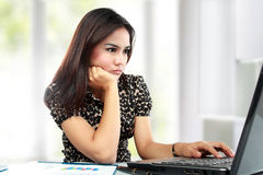 Busy business woman working at her office. Portrait of busy business woman working at her office Royalty Free Stock Images