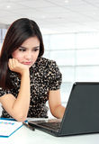 Busy business woman working with laptop at her office Royalty Free Stock Photo