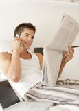 Busy Businessman in Bedroom Stock Photography