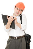 Busy businessman in his helmet Royalty Free Stock Photo