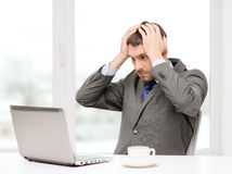 Busy businessman with laptop and coffee stock photography
