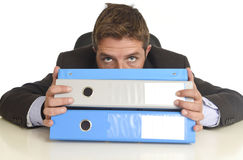 Busy businessman overwhelmed in stress at office exhausted holdi Stock Photo