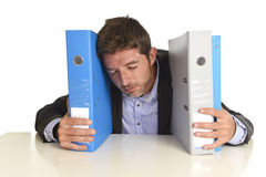 Busy businessman overwhelmed in stress at office exhausted holding paperwork folders Stock Photos