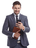 Busy businessman with phone and folders Royalty Free Stock Photo