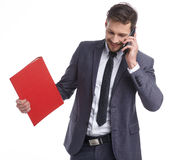 Busy businessman with phone and folders Stock Images