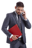 Busy businessman with phone and folders Royalty Free Stock Photography