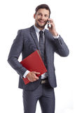 Busy businessman with phone and folders Stock Photo