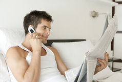 Busy Businessman with Phone and Paper Royalty Free Stock Photography