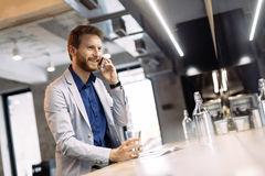 Busy businessman talking on phone Royalty Free Stock Photo