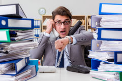 The busy businessman under stress due to excessive work Stock Image