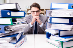 The busy businessman under stress due to excessive work Royalty Free Stock Image