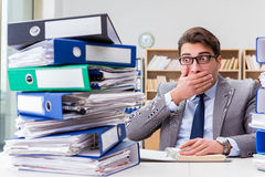 The busy businessman under stress due to excessive work Royalty Free Stock Images