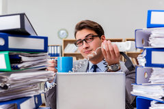 The busy businessman under stress due to excessive work Stock Photos