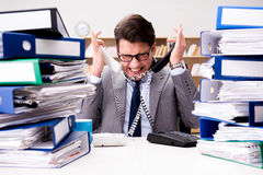 The busy businessman under stress due to excessive work Stock Images