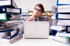 The busy businessman under stress due to excessive work. Busy businessman under stress due to excessive work Stock Image