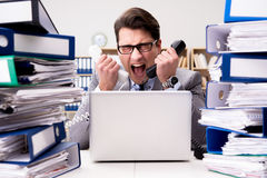 The busy businessman under stress due to excessive work Stock Photo