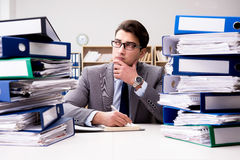 The busy businessman under stress due to excessive work. Busy businessman under stress due to excessive work Stock Photo