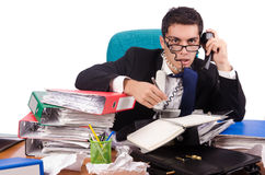 Busy businessman under work stress Royalty Free Stock Image