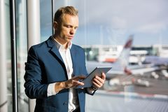Businessman using tablet in airport stock image