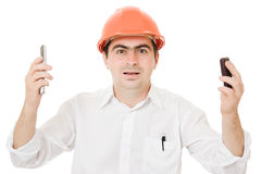 Busy Businessman Wearing A Helmet With A Phones Stock Photos